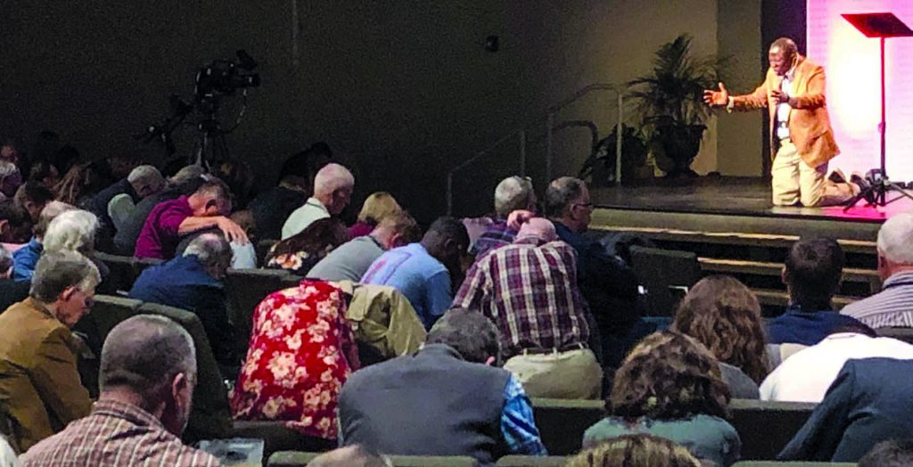 Shodankeh Johnson, an evangelist and church planter in the West African nation of Sierra Leone, prays for God's guidance during the Renew Gathering.