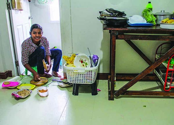 Angelina makes chapati for visitors to her one-room apartment in Bangkok.