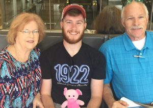 Hunter Wiederstein, center, with his grandparents, Allen and Jeanette Wiederstein.