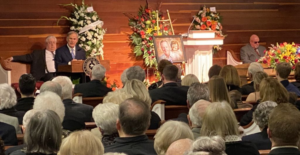 Texas Gov. Greg Abbott speaks at the funeral service for Richard White at Western Hills Church of Christ in Fort Worth, Texas.