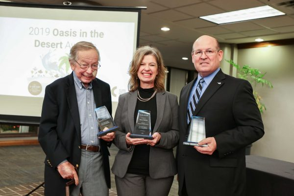 Larry Jurney, Dawn Shelton and Mark Thomas show off their Oasis in the Desert Awards from Oklahoma Christian.