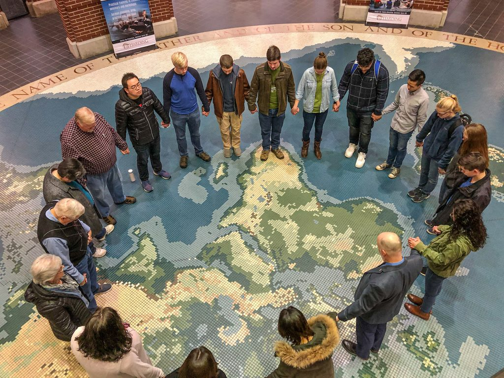Students, faculty and friends at Harding University in Searcy, Ark., pray Tuesday for China and the growing threat of the Coronavirus. They gathered in the McInteer Bible and World Missions Center.