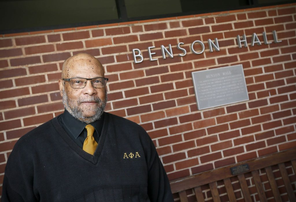 Robert Edison, the new Distinguished Visiting Professor of American Studies in Racial and Ethnic Diversity at Oklahoma Christian University, stands near a plaque at OC's Benson Hall with his name on it.