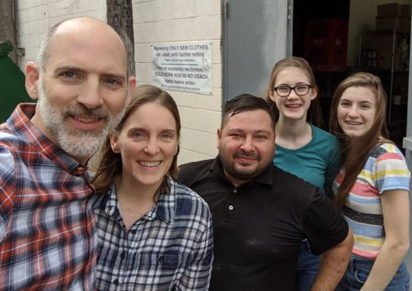 The Smith family with a worker from the Humanitarian Respite Center, in McAllen, Texas.