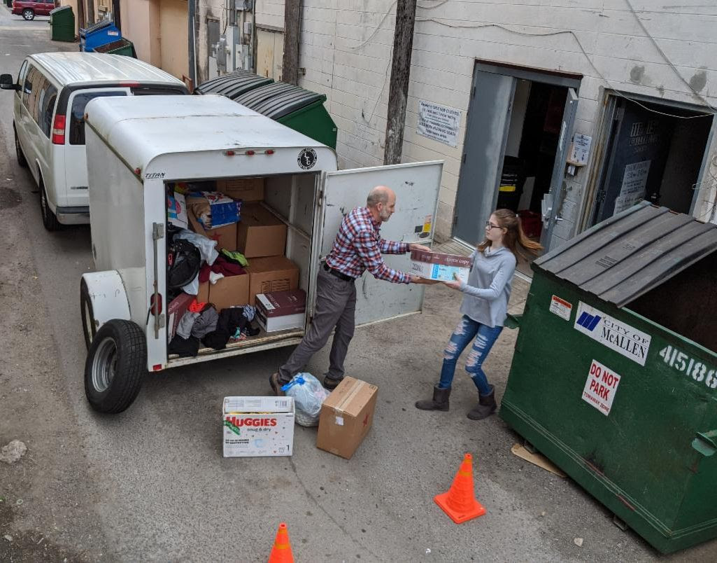 Luke Smith and his daughter unload donations at a respite center near the border.
