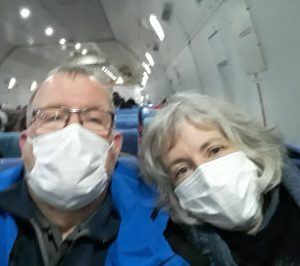 Dan and Cindy Roehrkasse were required to wear masks for the entire flight from China to the U.S.