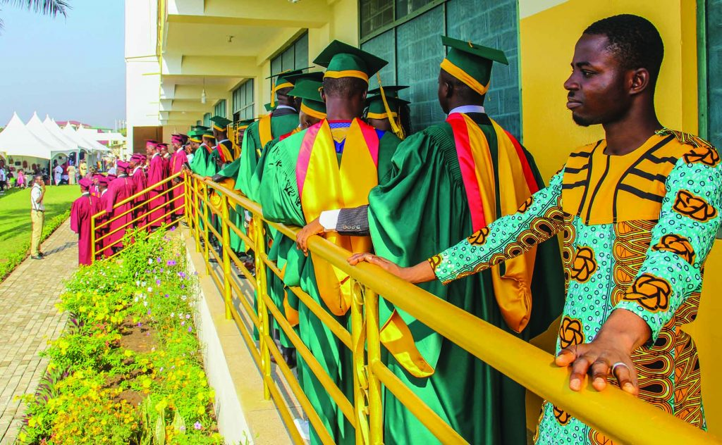 Heritage Christian College's first-ever graduates line up for a class photo on the school's campus in Accra, Ghana.