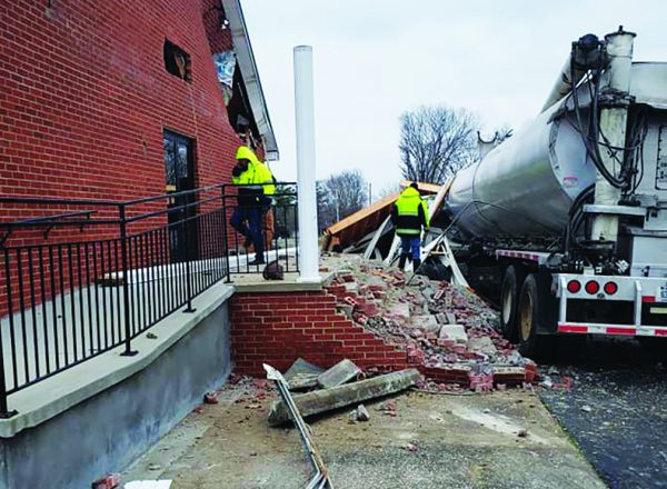 Authorities survey the damage to the Refuge Church of Christ building.