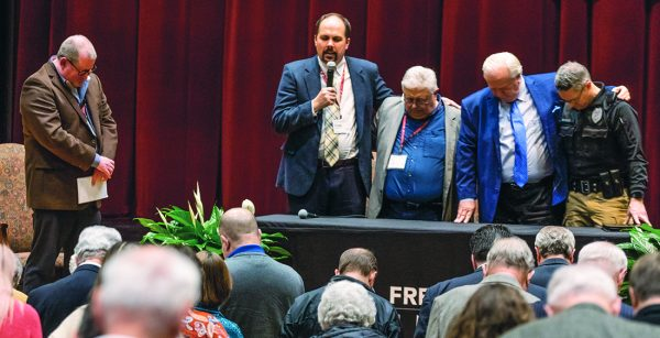 Doug Burleson, director of the Bible Lectureship at Freed-Hardeman University in Henderson, Tenn., leads a prayer at the conclusion of the panel discussion. Also pictured, from left, are Bobby Ross Jr., Britt Farmer, Joey Spann and Stewart Brackin.