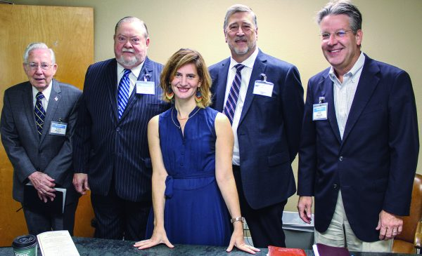 Christa Sanders Bryant with elders Ralph Rogers, Wiley Collins, Chris Parker and Andy Bennett at the New York Avenue Church of Christ in Arlington, Texas. The congregation's other elder, Charles Hervey, was teaching an adult Bible class.