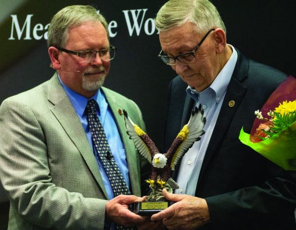 Sunset President Tim Burow, left, presents Bill Yasko with the Gray Eagle award, given to outstanding alumni of the institute.