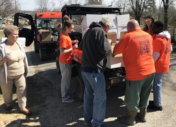 Mike Luke and other volunteers working with Disaster Assistance CoC and the Double Springs Church of Christ deliver food and supplies in a Cookeville, Tenn., neighborhood.