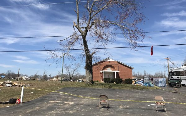 A mobile command vehicle of the Putnam County Sheriff's Office is parked beside the damaged McBroom Chapel Church of Christ building in a hard-hit neighborhood of Cookeville, Tenn.