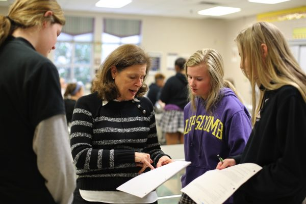 Patricia Woods works with her students at Lipscomb Academy in Nashville, Tenn.