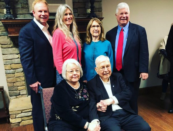 Cecil May Jr., bottom right, with his wife and children at a luncheon honoring him at Faulkner University in Montgomery, Ala.