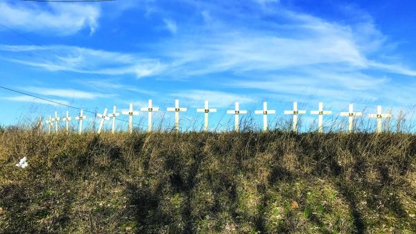 Memorial crosses near the March 3 tornado path in Cookeville, Tenn., pay tribute to the 18 people — 13 adults and five children — killed in Putnam County. A 19th Cookeville-area victim later died.