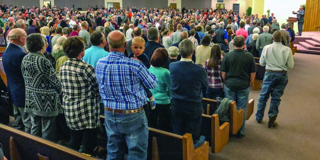"""Myron Bruce leads nearly 1,100 voices in worship during the opening night of Affirming the Faith, an annual seminar hosted by the North MacArthur Church of Christ in Oklahoma City. Participants from across the U.S. joined visitors from countries including Australia at the seminar, which had as its theme """"Reaching Higher: The Sermon on the Mount."""""""