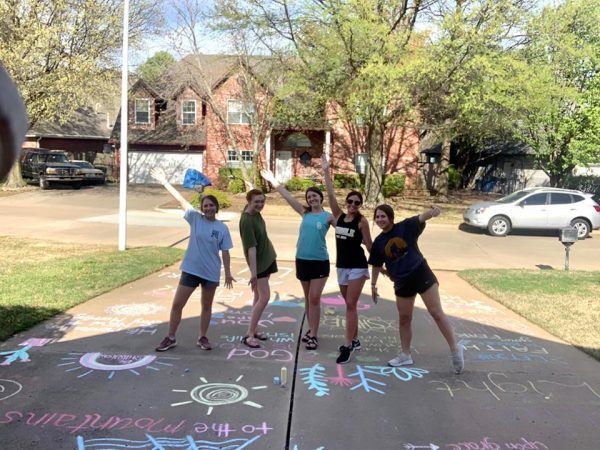 Avery Edison, Olivia Smith, Emily Turner, Kendall Ferguson and Ragan Edison, from the Broken Arrow church, stopped by to write encouraging messages in chalk on the Pyles' driveway while Tim and Coleman were sick.