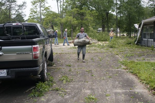 One Kingdom volunteers work on tornado relief in the Monroe, La., area.
