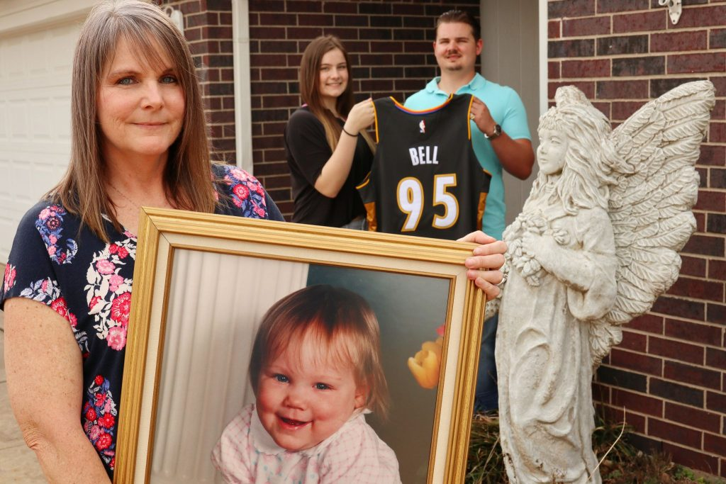 Deniece Bell-Pitner holds a portrait of her daughter Danielle, who was killed in the 1995 bombing. In the background are Bell-Pitner's son Brayden, 19, and daughter Dylann, 16, holding an Oklahoma City Thunder jersey created by the team to honor Danielle.
