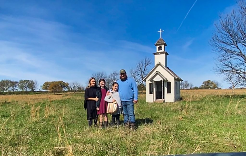 The Christ family outside their church building in rural Oklahoma.