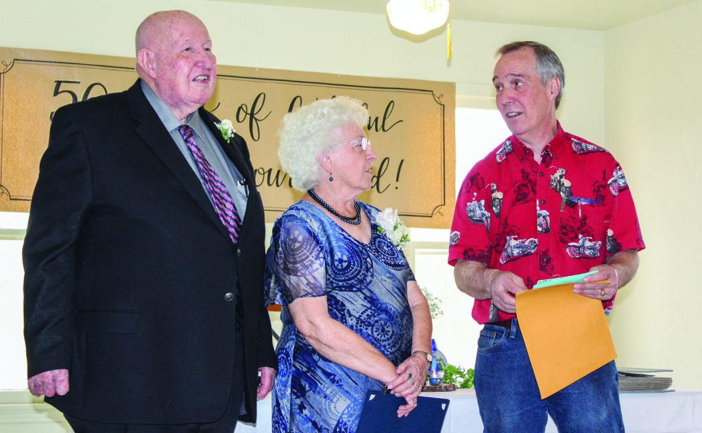 Martin and Mary Ann Smith are presented with a letter of thanks from the Bandera Church of Christ for their 50 years of service to the congregation.