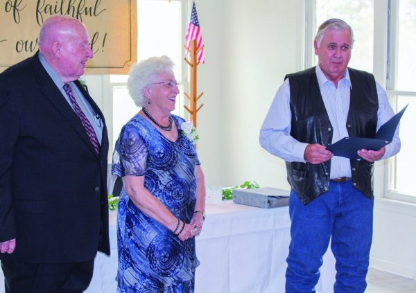 Bandera County Judge Richard Evans presents a proclamation to the Smiths for their service.