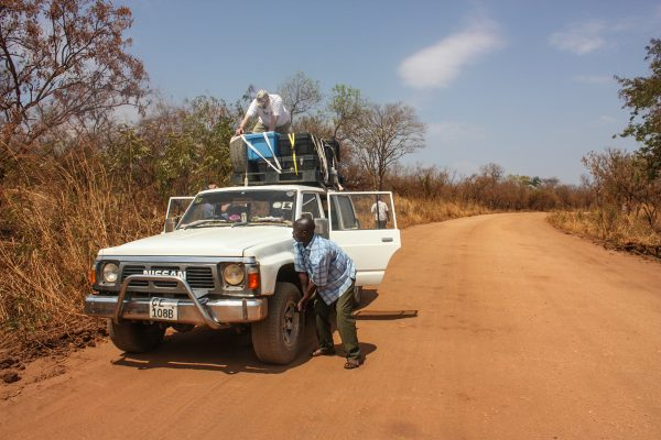 Checking the tires on the journey from Juba to Pajok, South Sudan.