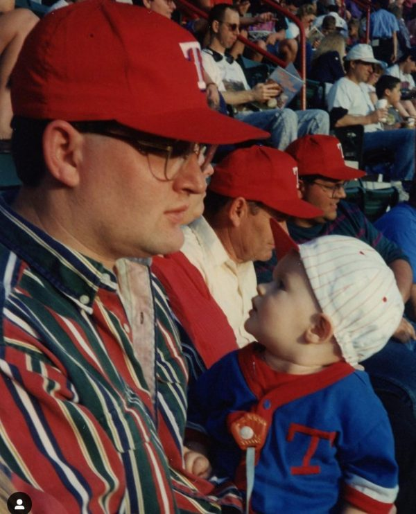 Bobby Ross Jr. enjoys a Texas Rangers game with his son Brady, then a baby.
