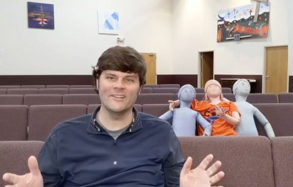With a few special guests in the audience, minister Adam Metz delivers a livestreamed message to the Alum Creek Church of Christ in Columbus, Ohio. The church received $21,000 through the federal government's coronavirus relief bill.