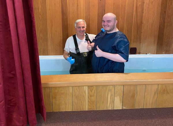Tim Hall baptizes Austin Carter.