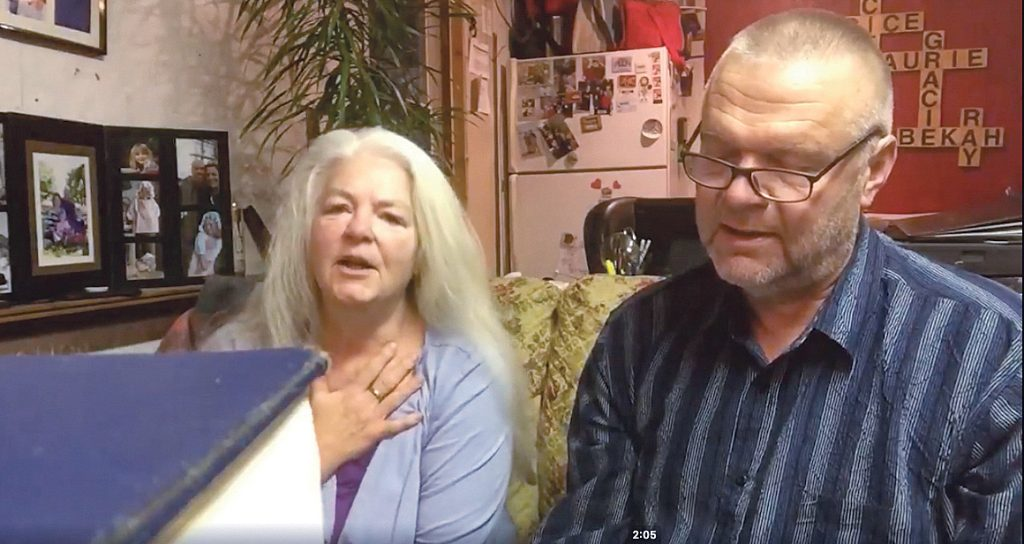 "During a ""song of the day"" broadcast for church members in Nova Scotia, Laurie and Ray Fisher sing ""Listen to Our Hearts."""