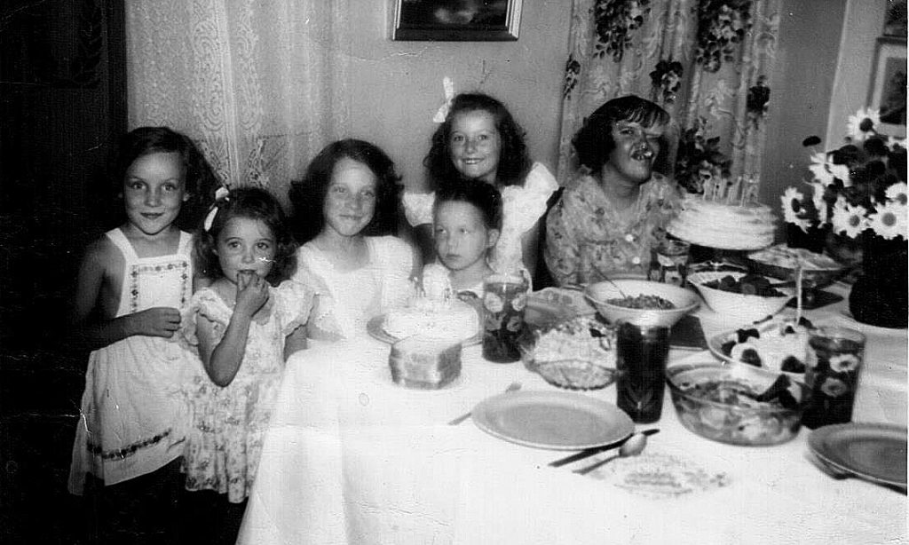 Kathleen Darby, far right, enjoys a niece's birthday party with family in 1946.