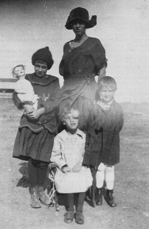 "Ruth Davis, known as ""Mama D,"" stands with her three oldest children in 1923. Kathleen, born in 1916, had multiple birth defects. ""People said that if you looked at Kathleen from her right side, you would never know she was different,"" said Kate Hooten, Davis' great-granddaughter, ""so in many pictures, that's the side that's showing."""
