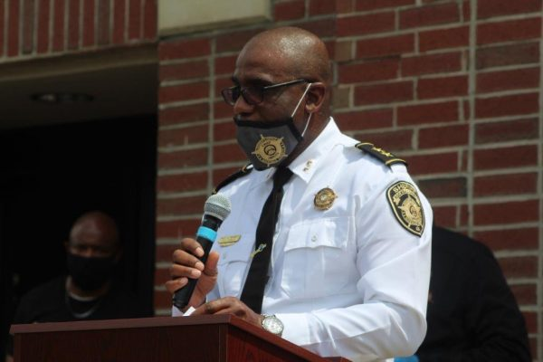 Dale Holmes, assistant chief of police for Rockdale County, speaks to the crowd during the prayer vigil.