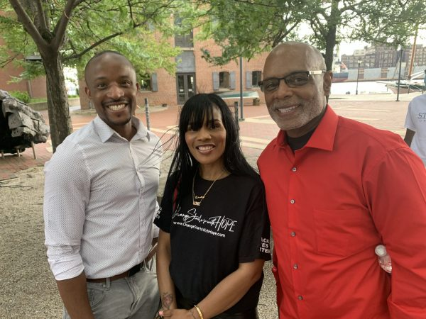 Samuel Knight, Shelly Edison and Elmer Sembly III at the rally.