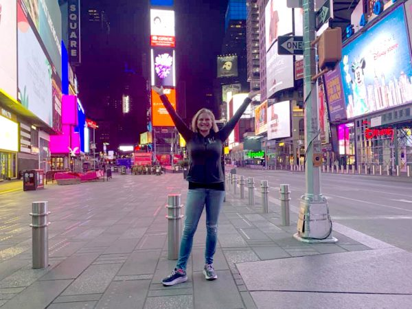 Kym Langford stands in the middle of Times Square. The area was practically empty due to shelter in place orders.