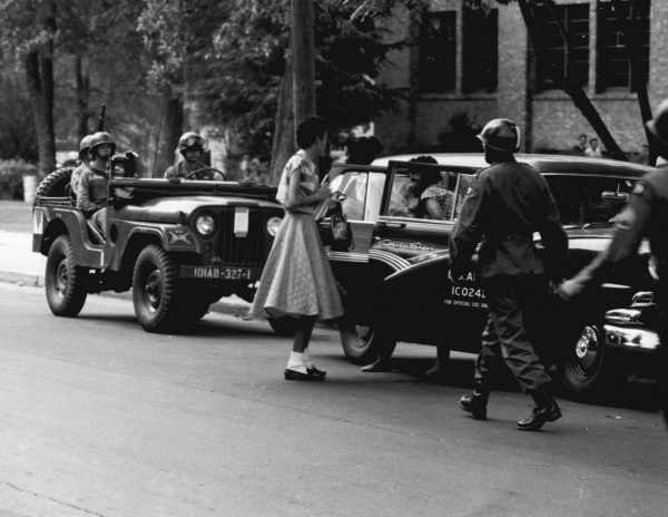 Soldiers from the U.S. Army's 101st Airborne Division escort black students to Central High School in Little Rock, Ark., in September 1957.