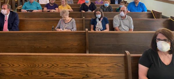 Some worshipers wear masks at the Washington Street Church of Christ in Fayetteville, Tenn.