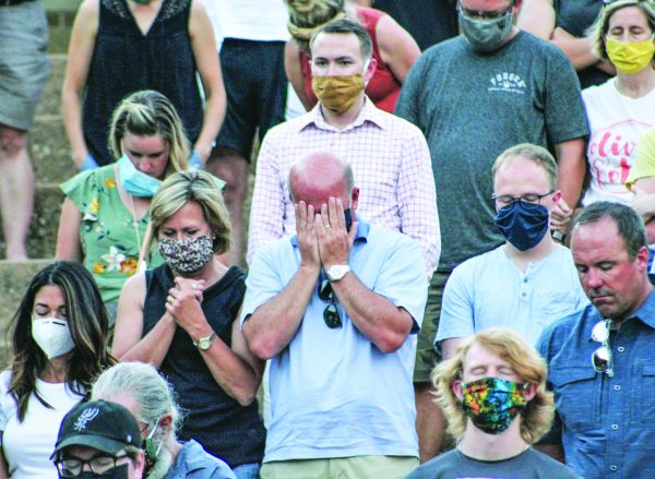 Heads bowed and eyes closed, those attending Sunday evening's community rally at Abilene Christian University prayed for dialogue and change at its end. The vast majority of the crowd was white.