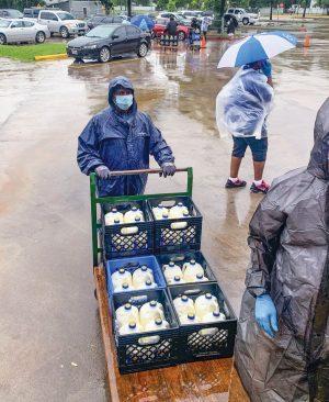 Dallas West member Chris Buford distributes milk.