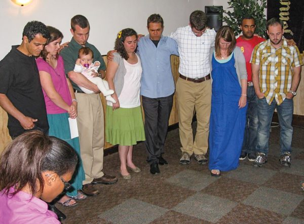 Members of the Igreja de Cristo Lisboa pray for the Angola Mission Team before its members, who studied Portuguese in Lisbon, move to the African nation in 2011.