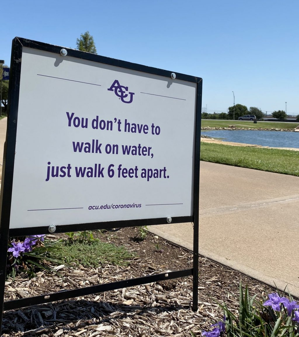 A sign on the campus of Abilene Christian University reminds everyone take safety precautions.