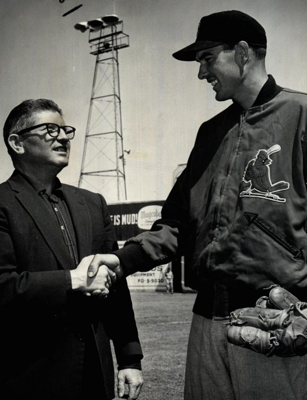 St. Louis Cardinals pitcher Lindy McDaniel, right, shakes an unidentified man's hand in a photo found in the archives of The Oklahoman, the largest newspaper in Oklahoma, where McDaniel grew up.