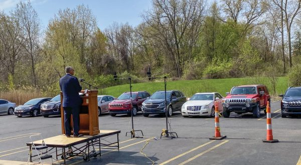 Edward Cribbs preaches at a drive-in service of the Oakland Church of Christ in Michigan.