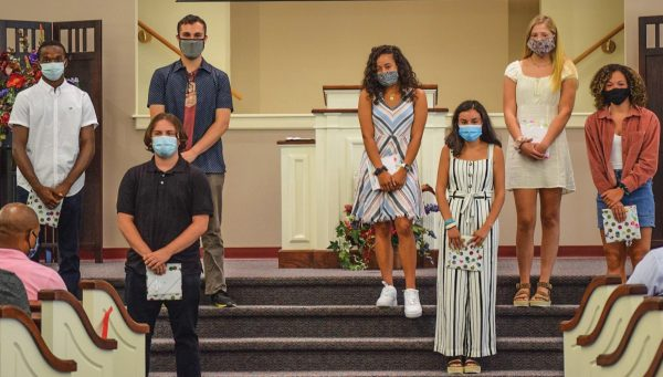 Teens wear masks during a baccalaureate service at the Manchester Church of Christ in Connecticut. The coronavirus pandemic has brought changes to such annual rites.