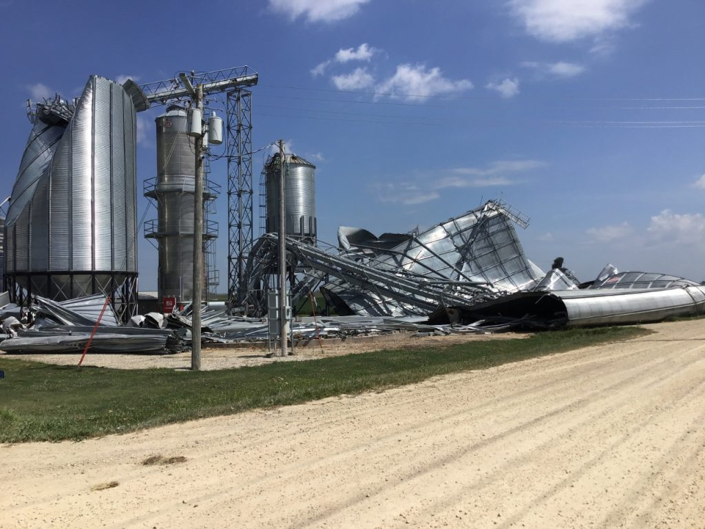 Agricultural storage and processing structures including grain bins, elevators, and dryers in w:Marion, Iowa damaged or destroyed by high winds of the w:August 2020 Midwest derecho.