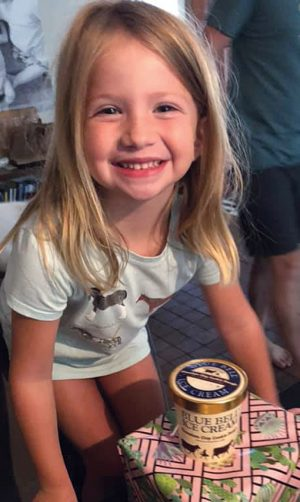 Scout Akins gets ready to enjoy some Blue Bell ice cream sent in a care package after her bout of COVID-19.