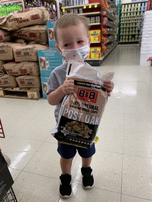 Bennett Ross, son of Brady and Mary Ross, wears a mask while shopping.