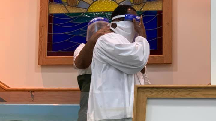 With special attire to prevent the spread of the coronavirus, a man is baptized at the Sharpe Road Church of Christ in Greensboro, N.C.